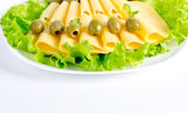 Cheese with lettuce and olives  — Stock Photo
