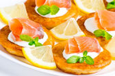 Sliced salted salmon served with pancake  — Stock Photo