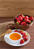 Strawberries, honey and cookies  — Стоковое фото