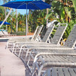 Pool sun loungers — Stock Photo