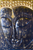 Closed up face Buddha statues — Stock Photo