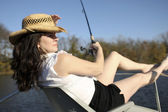 Mature Woman Fishing on a Boat — Stock Photo