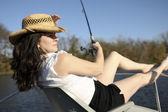 Mature Woman Fishing on a Boat — Stock Photo