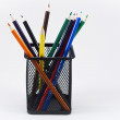 Stock Photo: Color Pencils in Black Pencil Holder on White Background
