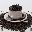 Coffee Beans Overflow Coffee Cup on Isolated White Background — Stock Photo
