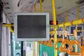 Handles for standing passenger inside a bus — Stock Photo