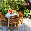 Постер, плакат: Able and chairs in garden