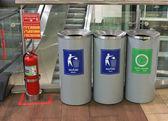 Three bins in shopping mall — Stock Photo