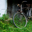 Old bicycle near house — Stock Photo #19595265