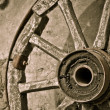 Stock Photo: Wooden wheel on wall