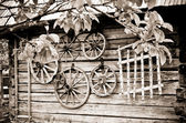 Old house with wooden wheels — Stock Photo