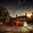 Ruins of old house in the starry night at startrails and moonl — Stock Photo