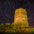 Old tower in the night at startrails — Stock Photo