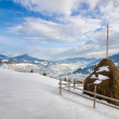 Haystack on the top of snow mountain — Stock Photo