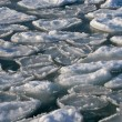 Frozen ocean - broken piece of ice in sea water — Stock Photo #39458219