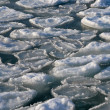 Frozen ocean - broken piece of ice in sea water — Stock Photo