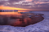 Frozen pier and ocean ice sunrise — Stock Photo