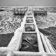 Frozen pier and ocean waves — Stock Photo