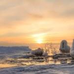 Frozen pier and ocean ice sunrise — Stockfoto