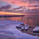 Wave on frozen ocean at sunrise light — Stockfoto