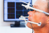 Doctor controlling man the position of mandible in medicalcenter — Stock Photo