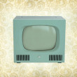 Vintage Antique TV  on a vintage wallpaper - Stock Photo