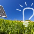 Stock Photo: Ecological renewable solarpanel over greenfield and blue sky