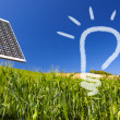 Ecological renewable solarpanel over greenfield and blue sky - Stock Photo