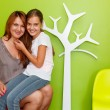 Mother with daughter, a jung girl, on his lap — Stock Photo