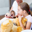 Doctor explains young mother and dauther how they ccare teeth — Stock Photo #29547915