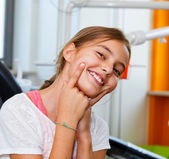 Funny and happy little girl in a dental surgery with big smile. — Stock Photo