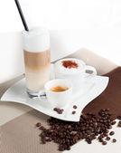 Latte macchiato cappuccino and Espresso with a lot of milkfroth — Stock Photo