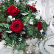 Bunch of roses with chrismas-tree decorations — Stock Photo