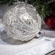 Silver christmas tree ball decoration on white table — Stock Photo
