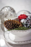 Pine cone and christmas tree decorations in a stew pan — Stock Photo