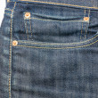 Front pocket with a seam on the blue jeans — Stock Photo