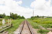 Long straight piece of rail track — Стоковое фото