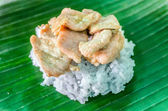 Barbecu pork and sticky rice on banana leafs — Stock Photo
