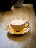 A Latte Coffee art on the wooden desk. — Foto de Stock