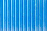 Blue grooved metal texture — Stock Photo