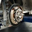Stock Photo: New brake pads and cylinder brake drum
