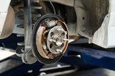 New brake pads and cylinder brake drum — Stock Photo