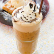 Iced coffee with ice and cream — Stock Photo #39868429