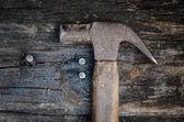 Hammer on wood — Stock Photo