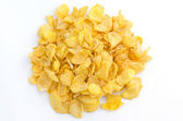 Small sampling of corn flake cereal, isolated — Stock Photo