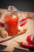Sauce adjika with red hot chilli pepper — Stock Photo