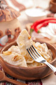 Ukrainian dumplings with stewed cabbage — Stock Photo