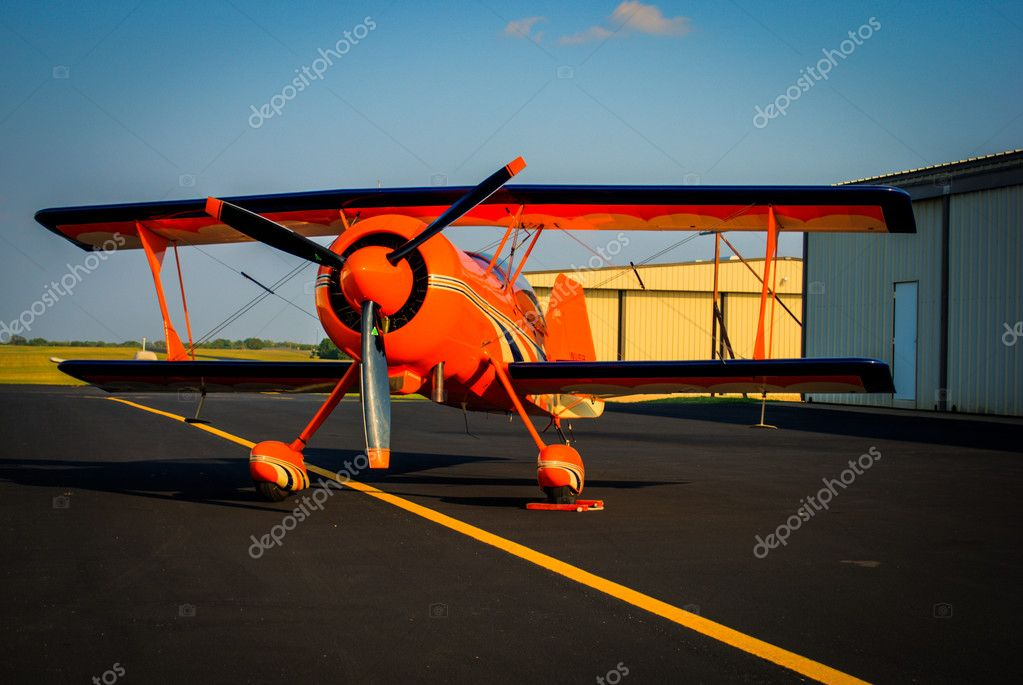 A Model-12 Pitts aircraft in orange. — Stock Photo #17817155