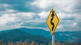 Curve Traffic Sign Blur Landscape Background — Stock Photo