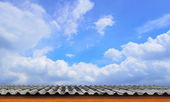 Roof-Tile and Cloudy Blue Sky — Stock Photo
